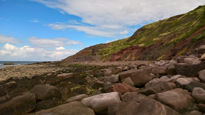 Looking over the boulder strewn intertidal area towards Saltom Pit